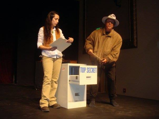 Antoinette Grajeda and Flip Putthoff, playing the role of Indiana Jones, look for secrets in unexpected places.