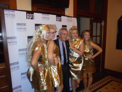 Emcee Daniel Ferritor, interim chancellor for the University of Arkansas, joins the Trump girls for a photo.