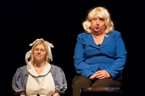 Vivian Cummings as Alice in Wonderland and Katherine Shurlds as Hillary Clinton.