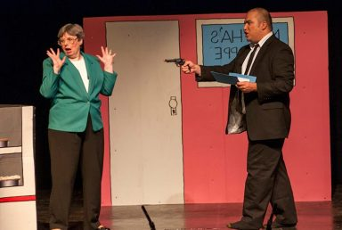 Debbie Miller as state auditor Martha Shoffner and Tony Hernandez as the FBI Pie Guy.