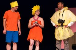 Kevin Kinder as Bart Simpson and Erin Spandorf as Lisa Simpson get lectured by a hazardous waste responder played by Justin Stewart.