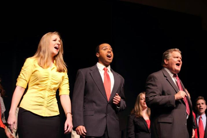 "During the closing sketch of Act 1, Jocelyn Murphy, Justin Stewart and Rusty Turner sing as part of the finale, ""We the People."""