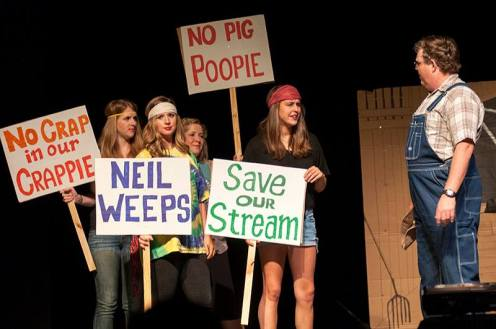 Buffalo River protesters try to stop a pig farmer, played by Wayne Tomlinson.