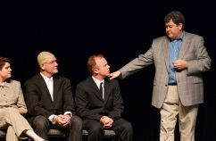 Ray Minor provides bad news to the university administration, played by Sarah Warnock, Zeek Martin and Kevin Kinder.