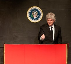 Zeek Martin plays former President Bill Clinton in a whack-a-mole sketch.