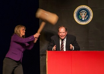 Channing Barker whacks a mole, in this case former president George W. Bush, played by Charlie Alison