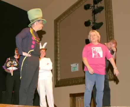 Charlie Alison as the Mad Hatter and Brenda Blagg. In the background is Gina King as the White Rabbit.