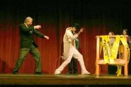 Grady Jim Robinson as Bill Clinton, following the gyrations of Elvis, played by Dusty Higgins.