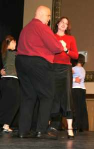 Mark Young and Amy Cochran dance to a song about digital things.