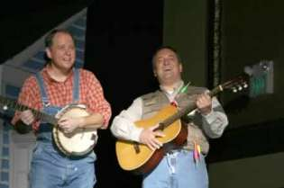 Charlie Alison as Buck Owens and Greg Harton as Roy Clark, hosts of Hee Haw.