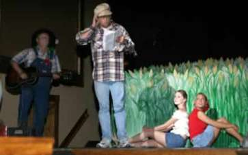 Kyle Kellams as the Hee Haw radio announcer, Charlie Farquharson.