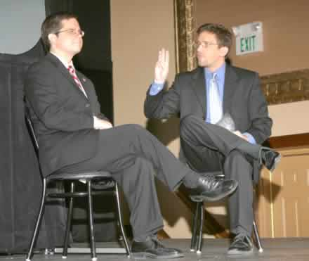 Jeff Smith as David Gearhart and Kyle Kellams as Regis Philbin asking whether there's a lifeline for $300 million.