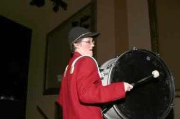 Sharla Bardin on drum.