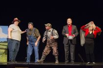 The chancellor of the university, played by Charlie Alison, visits duck hunters in south Arkansas.