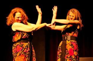 Stacey Roberts and Jocelyn Murphy debate dresses.
