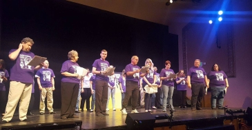 The full cast, dressed in purple T-shirts, rehearses the final sketch of the 2017 Gridiron Show.