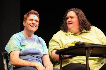 Sarah Warnock and Britt Graves get a sample of medical marijuana.