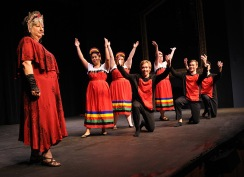 Katherine Shurlds leads dancers with a song for Mother Russia.