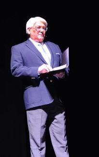 Emcee Steve Clark, president of the Fayetteville Chamber of Commerce.