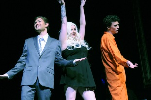 Ashley Eley as Stormy Daniels is serenaded by Henry Aggus and Nathan Owens.
