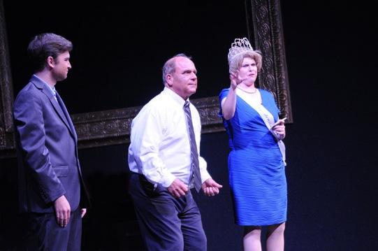 Sarah Warnock, left, portrays Regina Hopper hosting a contest, er, debate between candidates for the 3rd Congressional District.