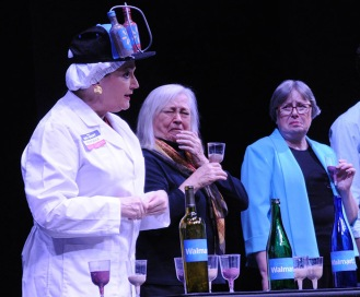 Stacey Roberts provides samples of Walmart wine, much to the disatisfaction of connoiseurs, played by Brenda Blagg and Debbie Miller