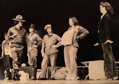 The Sarge, played by Dennis Oneal, reviews the new recruits, including Becky Brewer at right, who remains poised.