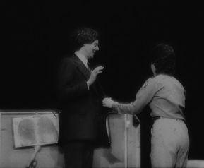 Peter Tooker as Gov. Bill Clinton is sworn in for posteriority.