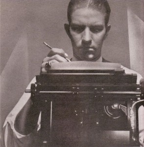 Photo of Ernie Deane with a typewriter